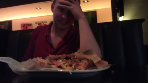 Ed is defeated by the biggest plate of nachos I've ever seen en route in San Francisco