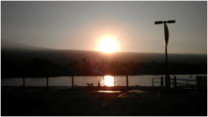 Sunrise from Kailua Kona Pier before the practice swim start